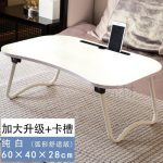 A Foldable And Versatile Table On The Bed Of A Lazy Person